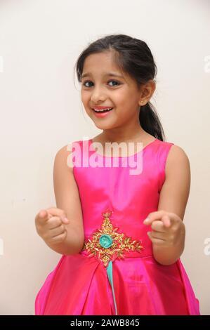 Mumbai, Maharashtra, India- Asia, Feb. 28, 2019 - Eight years Indian happy little cute girl smiling wearing beautiful pink dress - Stock Photo