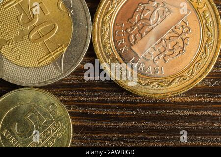 Turkish coins on a dark wooden background. lira from Turkey close up - Stock Photo