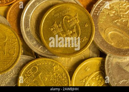 Coins of different countries. a lot of metal coins of different denominations and various countries. financial background. swedish cent in the foregro - Stock Photo