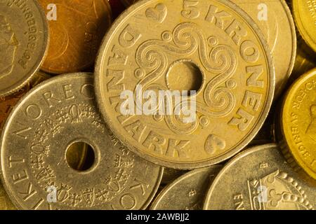 Coins of different countries. a lot of metal coins of different denominations and various countries. financial background. swedish krone in the foregr - Stock Photo