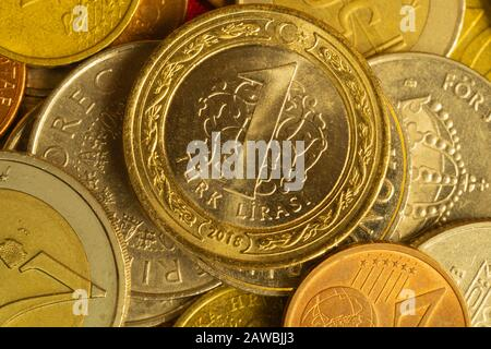 Coins of different countries. a lot of metal coins of different denominations and various countries. financial background. turkish lira in the foregro - Stock Photo