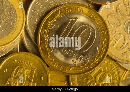 Coins of different countries. a lot of metal coins of different denominations and various countries. financial background. rubles in the foreground - Stock Photo