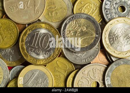 Coins of the different countries. a lot of metal coins of different denominations and various countries. finance background - Stock Photo