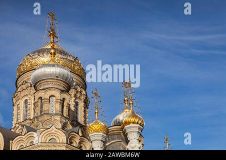 18 September 2018: St Petersburg, Russia - Church of the Assumption of Mary, on the Neva Embankment, detail of the onion domes, richly decorated in go - Stock Photo