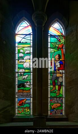 A 20th Century Stained Glass Window depicting a Pastoral Scene, within the Church of St Michael and All Angels next to Ford Castle in Northumberland. - Stock Photo