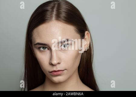 closeup portrait of cute girl without makeup with towel