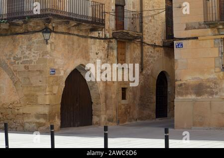 The Renaissance town hall and surrounding cobbled streets of Arnes, a medieval fortified town in Els Ports natural park, Catalonia - Stock Photo