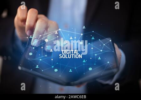 Businessman holding a foldable smartphone with DIGITAL SOLUTION inscription, new technology concept
