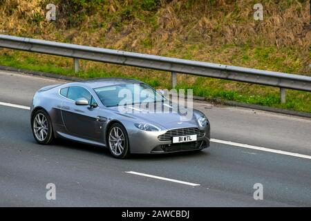 2015 silver Aston Martin Vantage V8 Auto; UK Vehicular traffic, transport, modern, saloon cars, on the M61 motorway highway. UK - Stock Photo