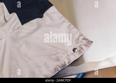 Laundry worker in the process of cleaning fur brush - Stock Photo