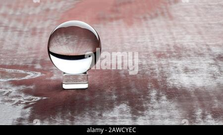 Magic crystal ball on brown background. copy space