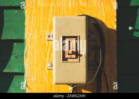 Vintage electrical switch panel. retro power toggle on the wooden wall - Stock Photo