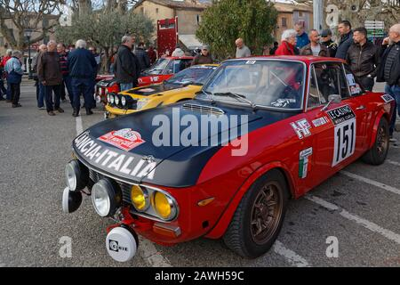 BUIS-LES-BARONNIES, FRANCE, February 1, 2020 : Starting park of Historic Monte-Carlo Rally. This 23rd edition hosts 310 teams from 28 countries with 4 - Stock Photo
