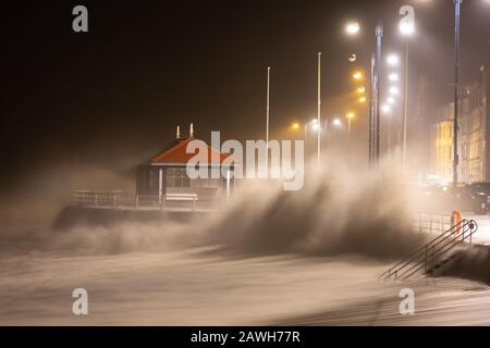 Aberystwyth, Ceredigion, Wales, UK. 09th February 2020 UK Weather: Storm Ciara stirs up huge waves as they bash the sea defences along Aberystwyth promenade this morning. © Ian Jones/Alamy Live News - Stock Photo