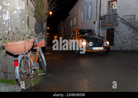 SAINT-NAZAIRE-LE-DESERT, FRANCE, February 4, 2020 : Historic Monte-Carlo Rally runs in the night. This 23rd edition hosts 310 teams from 28 countrie - Stock Photo