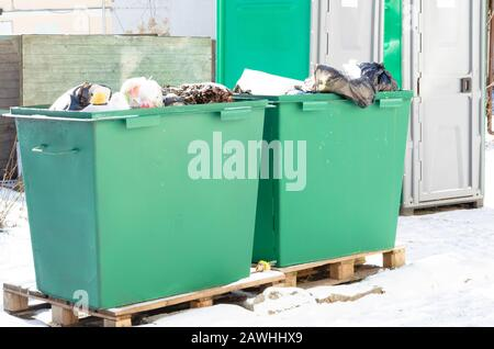 Green containers filled with garbage. Environmental pollution - Stock Photo