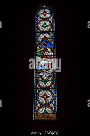 A Victorian Stained Glass Window depicting Christ in a Boat, within the Church of St Michael and All Angels next to Ford Castle in Northumberland. - Stock Photo