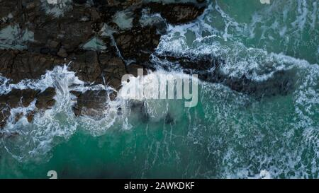 Drone picture of Haukland beach. Aerial photo of beautiful seashore on Lofoten islands. North of Norway. Waves hitting the shore of arctic beach - Stock Photo