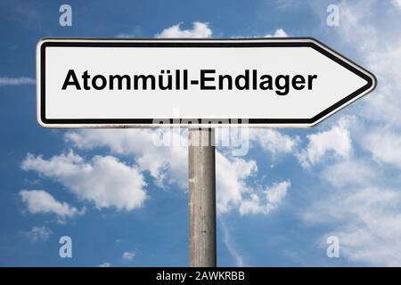 Detail photo of a signpost with the inscription Atommüll-Endlager (Nuclear waste repository) - Stock Photo