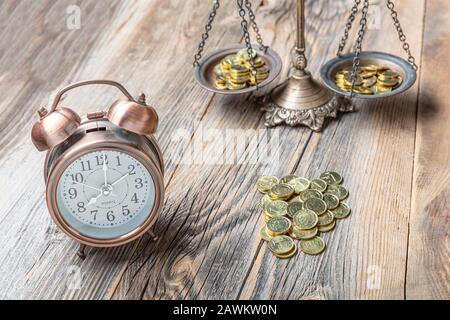 Alarm clock on stack of coins in concept of savings and money growing or energy save. Business investment growth concept. money saving and Investment. - Stock Photo