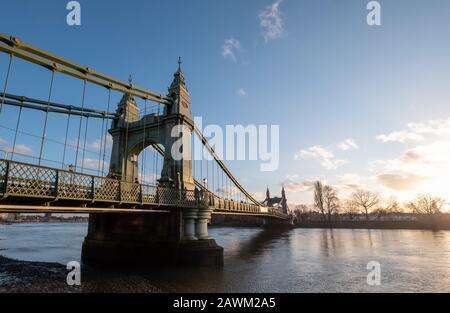 Hammersmith Bridge, iconic Victorian suspension bridge spanning the river Thames in west London, UK - Stock Photo