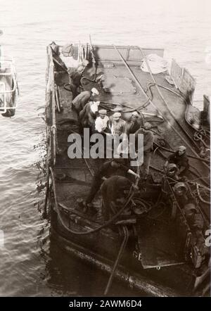 Seafarers on a tugboat in Genoa harbor (1930, Italy) - Stock Photo