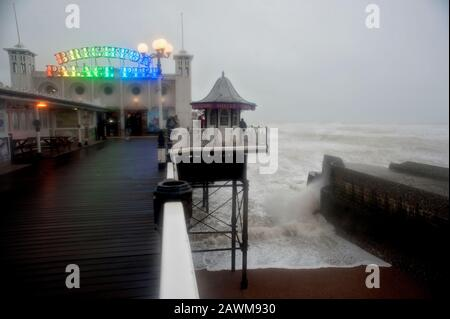 Gale force winds of up to 80 mph on Brighton Pier as Storm Ciara batters the south coast of England in 2020. - Stock Photo