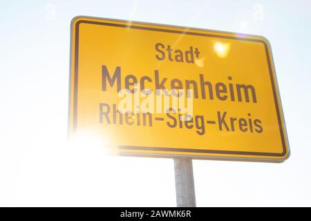 town entrance sign Meckenheim, sunny sky - Stock Photo