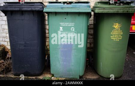 Three different trash bins, recycling and landfill - Stock Photo