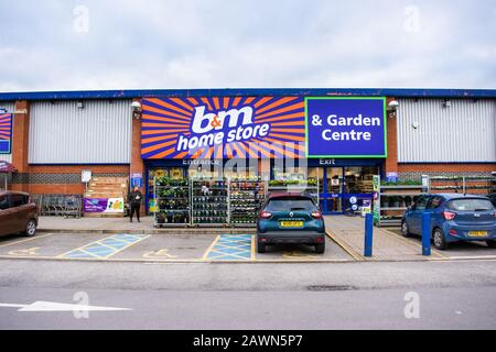 Front of a B & M homestore and garden center with racks of plants outside in Trowbridge Wiltshire - Stock Photo