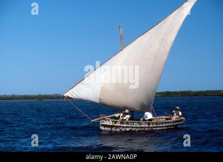 Sailing dhow with lateen sail, island of Lamu off the Indian Ocean coast of Kenya. Lamu once principle trading route of ancient swahili culture along the coast of East Africa from Arabia to Zanzibar and beyond. - Stock Photo