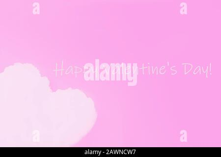 Happy Valentine's Day, greeting card. Pink background. White cloud in shape of a heart on pink background - Stock Photo