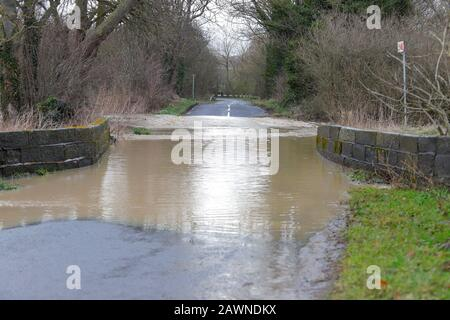 Flooding on Ledston Mill Lane in Ledston, West Yorkshire, after Storm Ciara brought flash flooding throughout the UK. - Stock Photo