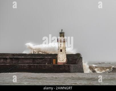 Storm Ciara battering a light house on the Cumbrian coast