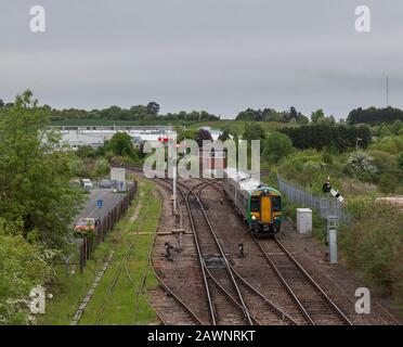 West MIdlands railway Bombardier class 172 at  Droitwich Spa with lower quadrant semaphore railway signals and signal box - Stock Photo