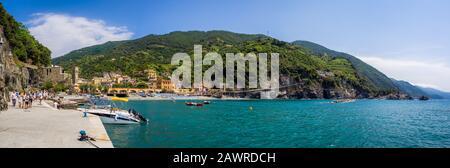 MONTEROSSO, ITALY - Jul 07, 2019: The sea and sandy beach Spiaggia di Fegina at the Cinque Terre Italy resort village of Monterosso al Mare with touri - Stock Photo