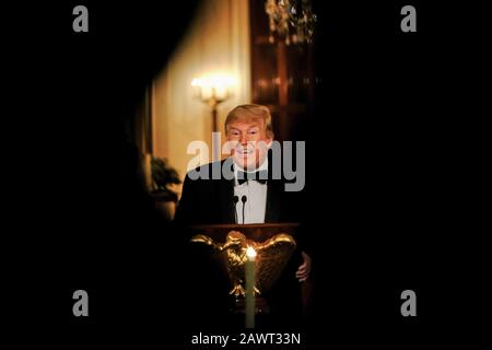 Washington, USA. 9th Feb, 2019. United States President Donald J. Trump makes remarks during the Governors' Ball at the White House in Washington, U.S., on Sunday, February 9, 2019. Trump was recently acquitted by the US Senate in the impeachment trial. Credit: Alex Wroblewski/Pool via CNP | usage worldwide Credit: dpa/Alamy Live News - Stock Photo