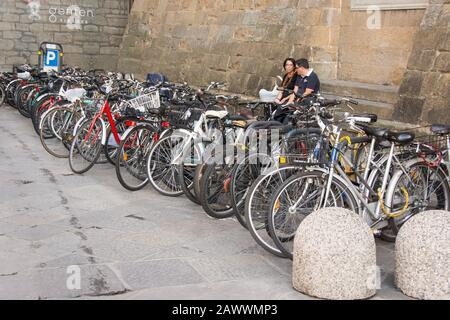 Italy.The city of Florence (Firenze).The bike is a great way to get around the city. - Stock Photo