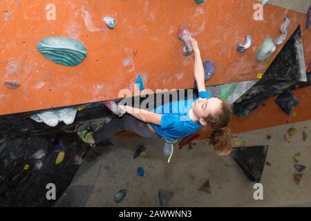 Child on a climbing wall , Young Boy Bouldering