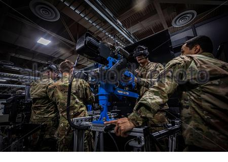 U.S. Army Soldiers with the New Jersey National Guard's D Company, 1-114th Infantry Regiment (Air Assault) train with a heavy weapons simulator at the Observer Coach/Trainer Operations Group Regional Battle Simulation Training Center on Joint Base McGuire-Dix-Lakehurst, N.J., Feb. 8, 2020. (U.S. Air National Guard photo by Master Sgt. Matt Hecht) - Stock Photo