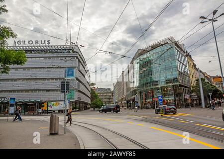 Zurich, Switzerland - June 10, 2017: Inner-city of Zurich with old and modern buildings. Tram rails in front. - Stock Photo