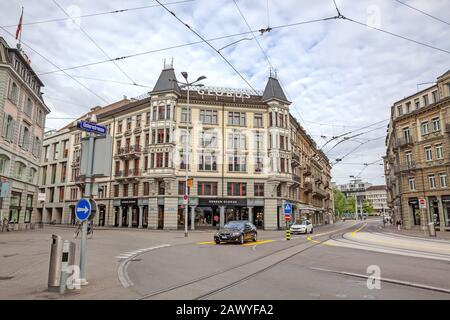 Zurich, Switzerland - June 10, 2017: Inner-city of Zurich with mall named globus in street Usteristrasse. Old buildings, tram rails in front. - Stock Photo
