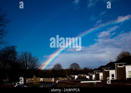 Rainbow after the storm, Droitwich Spa. Worcestershire, United Kingdom, 10/02/2020 , The rainbow glows in  full colour with the sun after the storm Ciara - Stock Photo