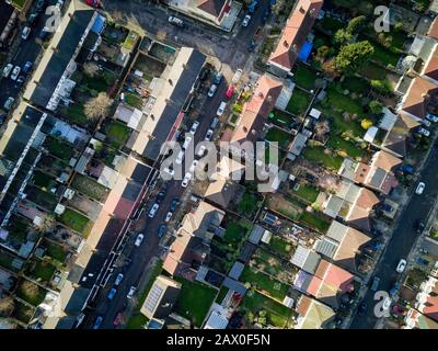 Aerial drone photo looking down vertically onto the rooftops of a typical North London suburban district. - Stock Photo