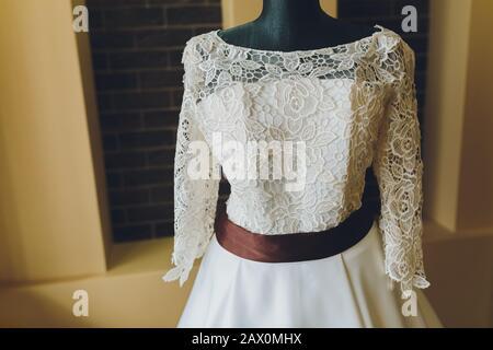 Modern white wedding dress isolated on Grey background - Stock Photo