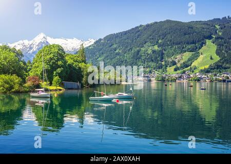 Scenic panoramic view of idyllic Zeller lake with old town Zell am See and snow-capped alpine mountain top Kitzsteinhorn, Salzburger Land, Austria - Stock Photo
