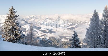 Panoramic winter view of  Kirchberg in Tirol and surrounding valley in the Kitzbühel ski area, Austria. - Stock Photo
