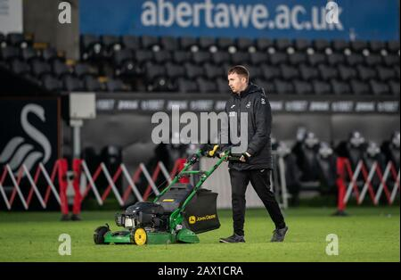 Swansea, UK. 08th Feb, 2020. Groundsman with lawnmower cuts the grass straight after the match during the Sky Bet Championship match between Swansea City and Derby County at the Liberty Stadium, Swansea, Wales on 8 February 2020. Photo by Andy Rowland. Credit: PRiME Media Images/Alamy Live News - Stock Photo