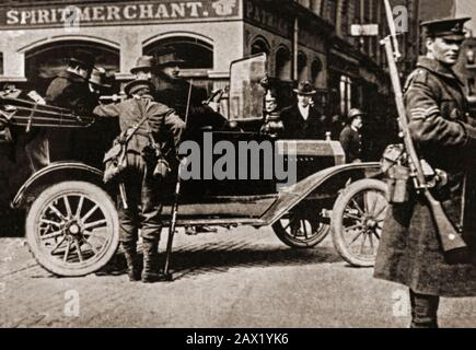 A military checkpoint in Dublin City, with soldiers checking cars for arms and republican fugitives after the 1916 Easter uprising. - Stock Photo