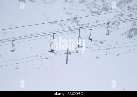 Chairlifts on ski area in winter - Stock Photo